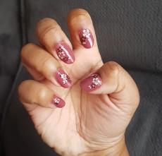 Flowery nail art on semi short nails